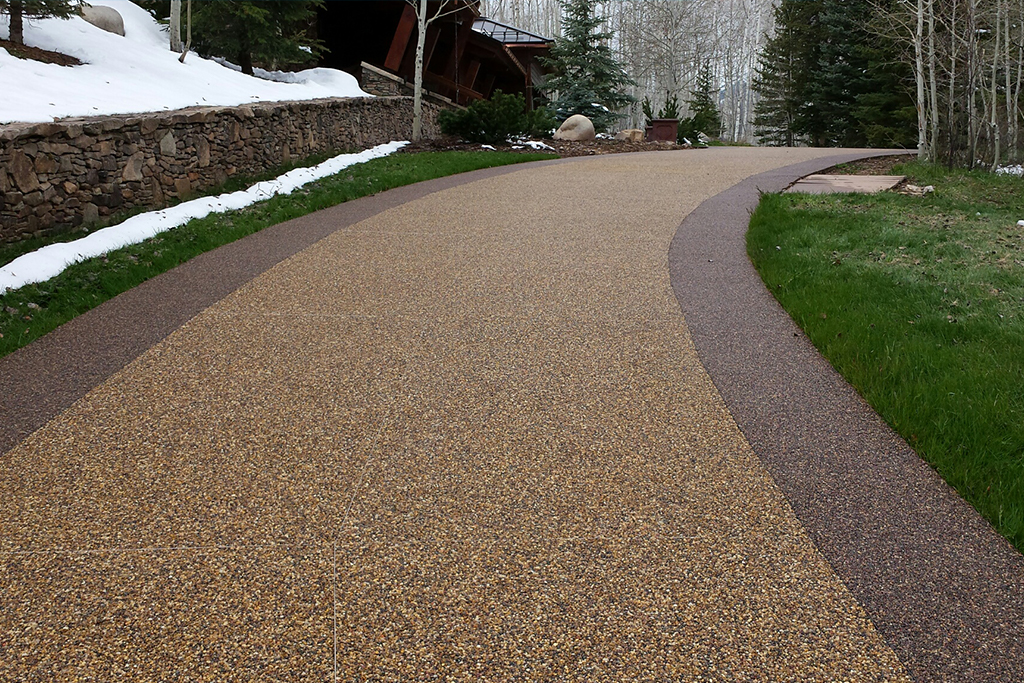 Beautiful polyaspartic top coat finish on a curved walkway.