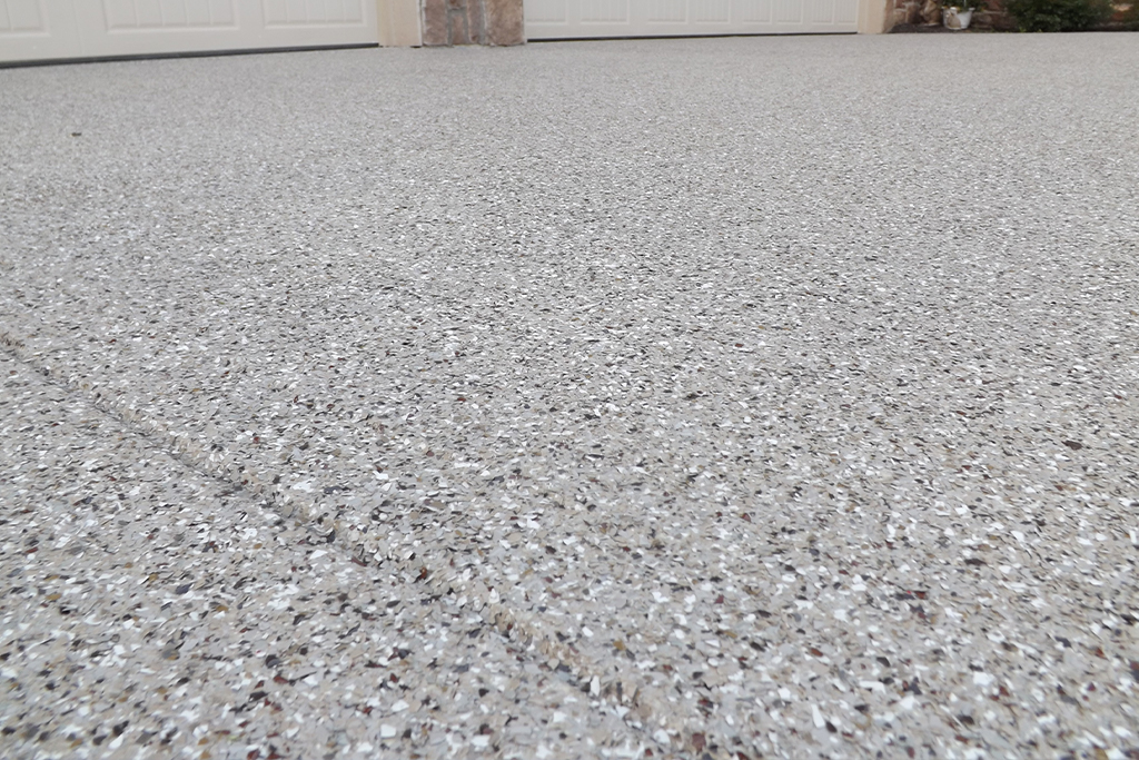 Polyaspartic top coat and flake on a driveway